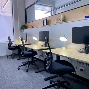 modern office space with 3 desks and decorations