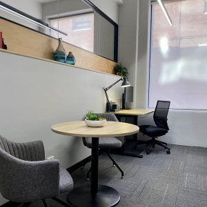 office with desk table and visitor chairs